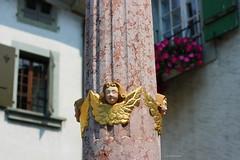 the angels of justice (overthemoon) Tags: flowers windows fountain 50mm schweiz switzerland suisse faades unescoworldheritagesite angels utata column svizzera cherubs cully vaud lavaux romandie thursdaywalk utata:project=tw375