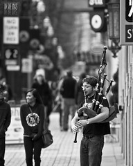 The Piper At 6th & Morrison (Ian Sane) Tags: street white man black oregon corner portland ian photography downtown bokeh candid images piper bagpipes morrison performer 6th sane the buenasnoches at