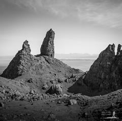 Old Man, Young Man, Tall Man, Short Man (Greg Whitton Photography) Tags: old sky bw mountain seascape man skye monochrome rock canon landscape scotland isle storr 40d hilghlands