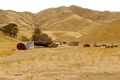 An assortment of old farm and ranching machinery and equipment. (openspacer) Tags: farmmachinery
