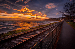 Train To The Sunset (Tim Shields BC) Tags: whiterock timshieldsphotography timshieldsvancouver tim shields vancouver canada sunset train tracks white rock ocean bcstorm