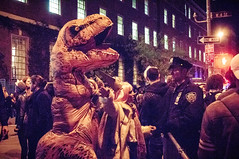 Halloween in NYC 2016 (cgc76) Tags: halloween village parade 2016 new york nyc manhattan street photography costumes horror low light 3200 iso awful lightroom sony nex 5t sel1670z trex costume dinosaur nypd police