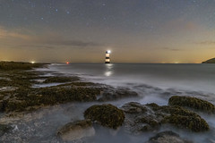 'Starlight Surf' - Penmon, Anglesey (Kristofer Williams) Tags: night sky stars penmon lighthouse beach coast landscape nightscape seascape sea waves longexposure penmonpoint anglesey
