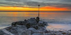Solent Glow (nicklucas2) Tags: seascape beach isleofwight needles sea groyne sunrise solent seaweed