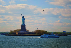 Statue of Liberty in New York (` Toshio ') Tags: toshio nyc newyorkcity newyork statueofliberty statue boat harbor bird clouds statenislandferry fujixe2 xe2 libertyisland island usa america ferry flag americanflag nationalpark