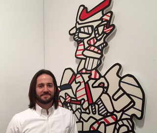 Gallery director Eduardo Tamayo of galleria Freites, Venezuela, at his booth at Art Miami