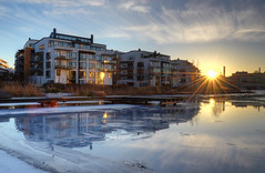 Back in Sea City II (Henrik Sundholm.) Tags: bridge houses sunset sun ice clouds buildings reflections sweden stockholm seats sverige hdr sunbeams waterscape sickla hammarbysjstad lightstar