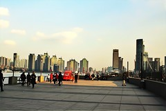 Looking back at the Bund and the Pudong district in the background (siddharthx) Tags: china sunset gold golden travels skies shanghai riverside dusk walk azure quay clocktower commercial pedestrians belvedere coffeehouse pudong bund saxophone blacklabel governmentbuildings oldlighthouse sauntering goldensunsets worldfinancialtower financialtower worldtrekker westinbundtower yondering