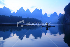 Fishermen on Li River (MPBHAIBO) Tags: china morning blue cloud mist mountain reflection bird water fog sunrise river landscape dawn liriver fishing fisherman asia dusk guilin yangshuo hill cormorant  relaxation  cloudscape stormcloud cumulonimbus  chineseculture  xingping ruralscene fishingindustry  karstformation chineseethnicity woodenraft  guangxiregion