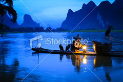 Li river fishermen (MPBHAIBO) Tags: china morning cloud mountain reflection tree water fog forest sunrise river landscape outdoors dawn liriver fishing fisherman asia dusk guilin yangshuo hill bamboo cormorant  relaxation cloudscape scenics occupation bamboorafting  chineseculture  rainhat urbanscene xingping ruralscene fishingindustry     karstformation chineseethnicity woodenraft  guangxiregion