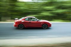 Bloody speedy red (Ct) Tags: road red speed streetscene romania panning hyundaicoupe romnia rou vitez iaicounty