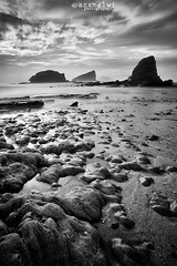 luminosity... (azam.alwi@maza) Tags: longexposure travel sea bw seascape beach stone sunrise indonesia landscape seaside slowshutter batu stonebeach jember leefilters semulajadi papumabeach