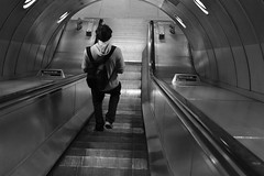 2013-06-14: The Down Escalator (165/365) (psyxjaw) Tags: blackandwhite bw london station underground walking jubilee escalator tube down an line backpack southwark londonist greyy