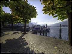 Bellagio, Lake Como (Luc V. de Zeeuw) Tags: clouds comolake ferry harbor trees water mooringpost bellagio lombardia italy