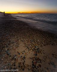 Spotlight On Pebbles (maureen.elliott) Tags: lakesuperior beach sand pebbles rocks sunset walking whitefishpoint michigan upperpeninsulaofmichigan water waves greatlakes