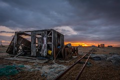 The rusty winch (James Waghorn) Tags: sigma1020f456 autumn beach net d7100 derelict sunset wreck rust railway pebbles kent dungeness clouds abandoned alone solitary quiet england winch rails