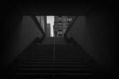 Near City Hall (Neal Edelstein) Tags: chicago illinois city hall stairs bw blackandwhite monochrome people person center dark black