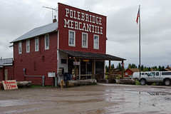 Polebridge Mercantile (bhophotos) Tags: travel red usa clouds geotagged store nikon montana glaciernationalpark flagpole countrystore polebridge polebridgemercantile d700 2470mmf28g northforkflatheadriver bruceoakley