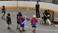 Watching the ball - Box  Lacrosse action - No. 9 shoots on goal (D70) Tags: canada game net boys face sport vancouver ball goal referee teams community bc with watches action box centre leg watching north saints harry masks national shore jerome recreation draw 55 lacrosse eagles racket poco pads helmets canadas umpire keeper