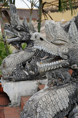 Dragon Statues at Pha That Luang (ollygringo) Tags: city travel tourism statue architecture temple asia southeastasia dragon stupa buddhist capital buddhism laos vientiane phathatluang