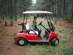 Golf Cart Adventure (BurlapZack) Tags: trees red tree forest woods cloudy overcast roadtrip homestead golfcart easttexas pineywoods bivinstx panasoniclumix14mmf25 vscofilm olympusomdem5 behindthepinecurtain golfcartadventure