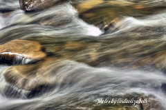 Water running over rocky bottom of a stream (lindaelizabeth) Tags: water rain closeup creek canon rocks zoom details slowshutter flowing rockybottom oneimage