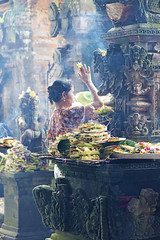 Pleasing the gods (Andrew Tan 2011) Tags: bali flower girl stone indonesia temple mood market smoke traditional prayer religion culture atmosphere carving offering gods ritual smoky tradition incense pasar ubud balinese thechallengefactory