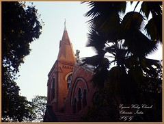 Egmore Wesley Church (Sam Godfrey George) Tags: cameraphone trees sky india building church george madras steeple spire wesley methodist chennai samuel godfrey edifice egmore