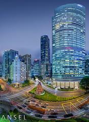 CITYSTREAM (draken413o) Tags: travel light panorama building night canon singapore place skyscrapers district trails fisheye business streaks raffles ntuc destinations vertorama 5dmk2