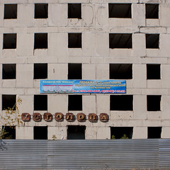 Construction Of A Building Stopped Because Of The Crisis, Kazakhstan (Eric Lafforgue Photography) Tags: building fence advertising square outside outdoors rust exterior empty nopeople structure advertisement hoarding disused centralasia kazakhstan kazakh crisis easterneurope dilapidated squarepicture burabay cyrillicalphabet economiccrisis cyrillicletters russianalphabet russianwritting kz6606