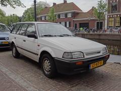 1993 Mazda 323 1.6 LX Estate (Skitmeister) Tags: auto holland classic netherlands car vintage automobile voiture oldtimer niederlande classique klassiker pkw  klassieker  carspot skitmeister gtnt11