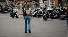 Enjoying Laughlin (Shot by Newman) Tags: bikes bikers babes jeans laughlinriverrun bikeweek bikerbabe cowgirlbiker walking enjoying southwest mojavedesert shotbynewman daylight nevada 35mm fujifilm fuji400 parkinglot old35mmminolta