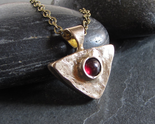 Bronze and garnet pendant