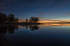 First Light (mclcbooks) Tags: dawn sunrise daybreak morning clouds light sky lake trees silhouettes reflections blue chatfieldstatepark lakechatfield colorado