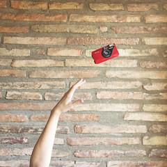 MY OLD KONICA (cristina or) Tags: autorretrato selfportrait volar fly camara camararoja retro konica mano hand levitacion levitation minimal minimalismo minimalism myoldkonica miviejakonica