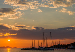 Setting Greek sun ( As seen from Sivota)  (Canon EOS 7D & EF 35mm f2 Prime) (1 of 1) (markdbaynham) Tags: greece greek grecia greka hellas hellenic sivota sunset sun clouds colour harbour boats view landscape canon canonites canonite eos 7d apsc dslr ef 35mm f2 prime
