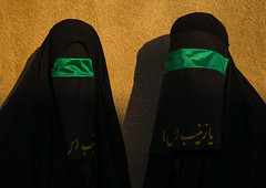 Portrait of iranian shiite muslim women with their faces hidden by a veil mourning imam hussein on tasua during the chehel manbar ceremony one day before ashura, Lorestan province, Khorramabad, Iran (Eric Lafforgue) Tags: 2people 30s adultsonly arabicalphabet ashura ceremony chador clothing colorimage covered face green hidden horizontal hussain imamhussein iran islam khorramabad lookingatcamera memorialevent middleeast mourners mourning muharram muslims mysterious mystery niqab outdoors people portrait religion religious ritual shia shiism shiite tasua twopeople unrecognizableperson veiled waistup woman women womenonly lorestanprovince ir