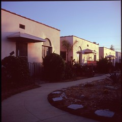 Bungalow court, Normandie (ADMurr) Tags: la normandie courtyard east hollywood rolleiflex fuji chrome slide film planar 6x6 square mf