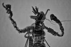 Super-Hero N&B (DarVit) Tags: sombre dark blanc fond surréaliste artistique artistic art metal plastic plastique handmade homemade cyborg toy iron acier fer fil cable wire jouet sculpture decoration fight combat recycled recycling recyclage assemblage robot screw vis glasses lunettes docteur doctor seringue noir monochrome superhero hero cape cap justice defend cyclope cyclop bec beak vent wind portrait