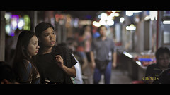 Women are ever fickle and changeable (Banana_Q) Tags: street girls food night photoshop prime nikon women singapore chinatown asians dof shot bokeh candid streetphotography 85mm stall explore f2 cinematic 169 tones frontpage select lightroom 18d april25 no17 d90
