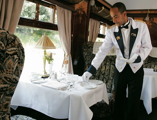 British Pullman - preparing the table on a luxury train in the UK