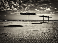 Beach (big andrei) Tags: sea bw beach sepia sand cyprus olympus zuiko e5 larnaca 1260mm