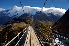 Aotearoa (PhotoArt Images) Tags: b bw mountain mountains nz polarizer swingbridge snowcappedmountains mtcooknationalpark hookervalleytrack nzsouthisland nikon2470mm28 flickrsfinestimages1 photoartimages swingbridgeinthehookervalley