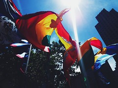 United (Dan Bathie) Tags: cameraphone nyc newyork colour flags lensflare rockefellercentre iphone iphoneography vscocam
