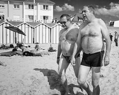 At the beach (Joris_Louwes) Tags: summer vacation holiday men beach belly speedo