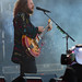 Jim James plays the guitar