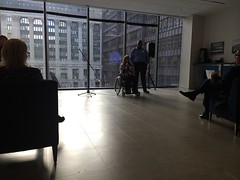 the presentation (KevinIrvineChi) Tags: blue light sun chicago silhouette foot floor cityhall space room wheelchair silhouettes meeting sunny microphone presentation backlit lit daleycenter pasystem daleyplaza chicagoist