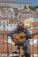Lisbon Cultural Icons (Tony Shertila) Tags: 20160817151132 castelo geo:lat=3871234807 geo:lon=913033068 geotagged lisboa portugal prt europe outdoor city culture icon weather day clear sky portrait fado guitar music player terrace rooftops cityscape