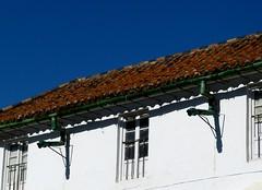 Una canaleta y su sombra (camus agp) Tags: fachada ventanas tejas malaga espaa fz150 tejado sombras casa pueblos