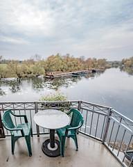 Balcony at river Havel (exkeks) Tags: bokehrama autumn fall river boat chairs table brenizer